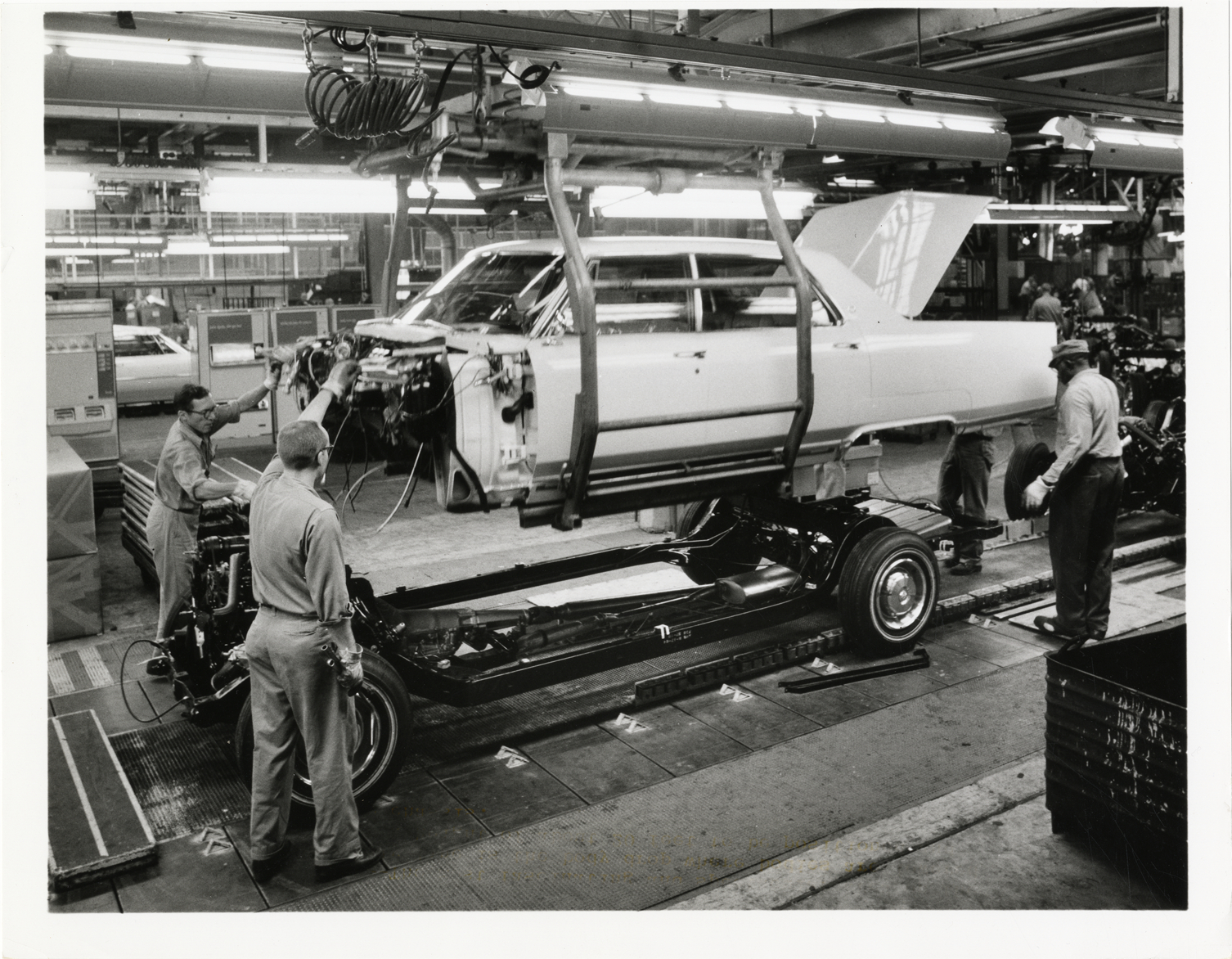Men working on 1966 Cadillac automobile on embly line | DPL DAMS