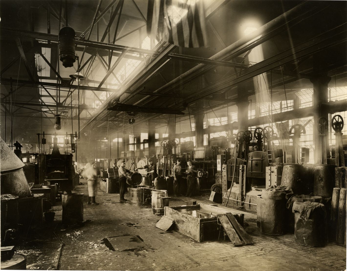 Workers with heat quenching tanks, Heat Treating Department, Chalmers Motor Company factory