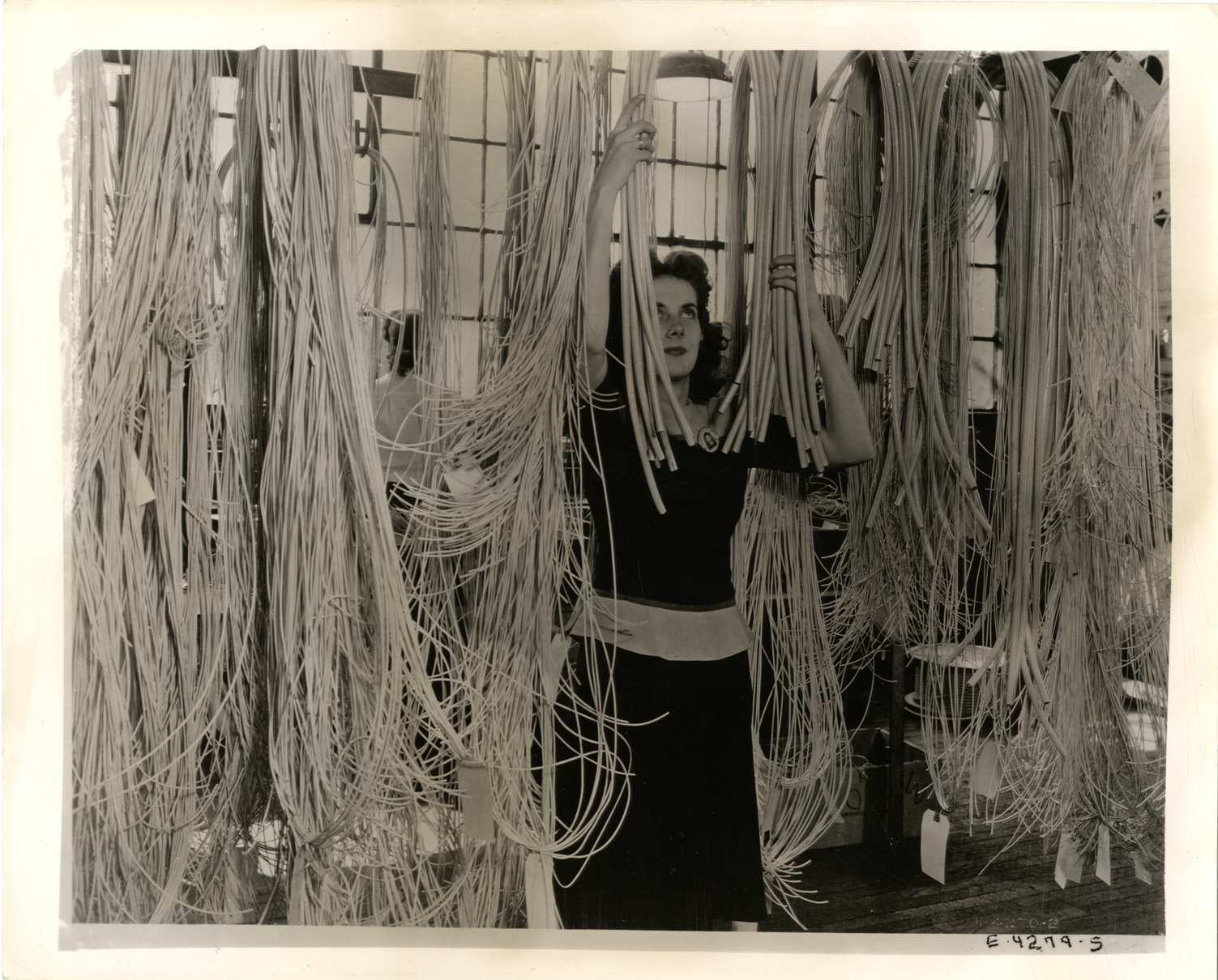 Rosemary Tremonti hanging wires for a B-29 Superfortress wire harness