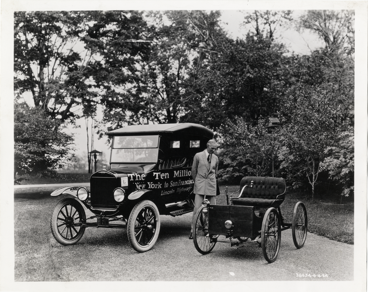 Henry Ford posing with first automobile and 10,000,000th Model T ...